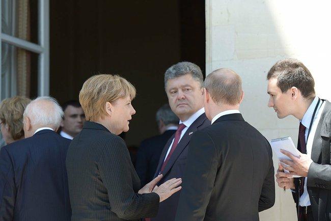 A. Merkel, P. Porosjenko og Valdimir Putin i Normandiet  Foto: Kremlin