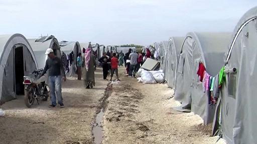 Kurdiske og syriske flygtninge i en flygningelejr ved grænsen til Tyrkiet  Foto: Wikimedia